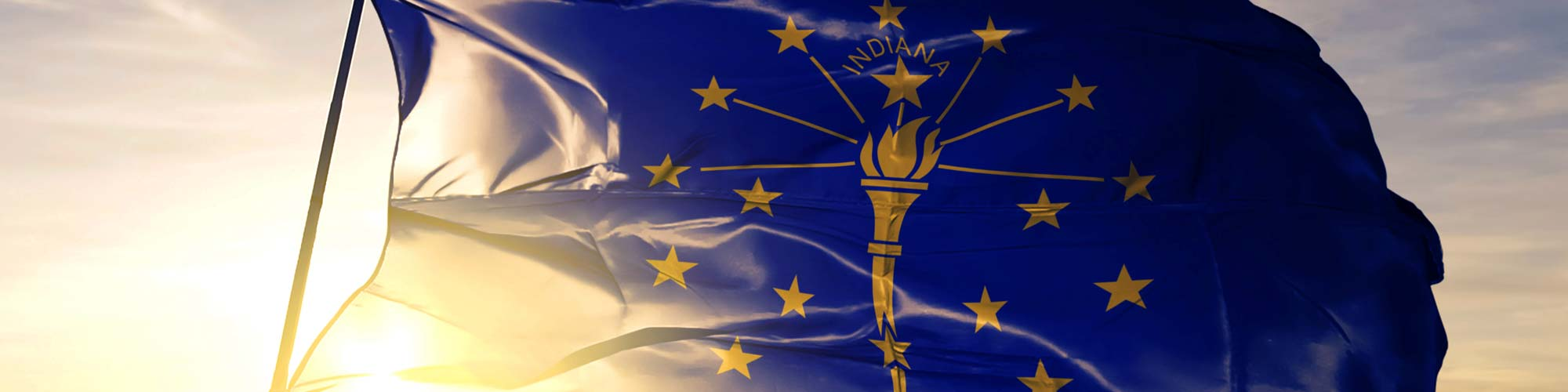 Indiana state flag at sunset