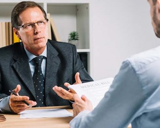 Injured worker consulting workers compensation lawyer