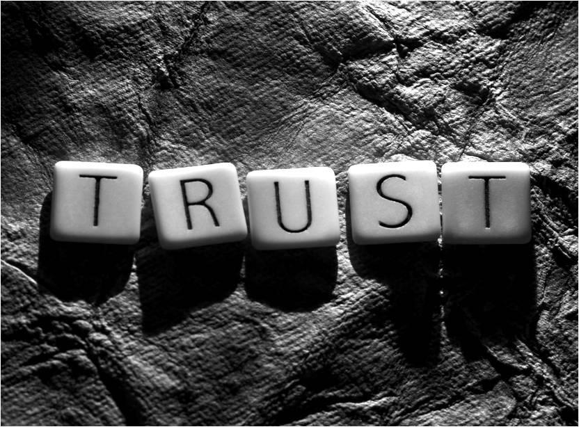 "Scrabble tiles spelling ""Trust"""