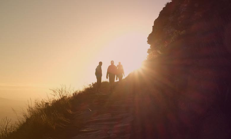 Sun rising on a group of hikers is like acknowledging the shadow existing in an organization