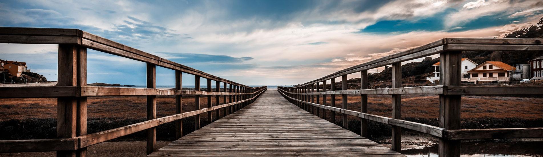 Boardwalk at a beach at sunset