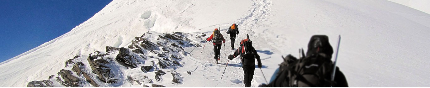 Climbing and summiting a snow-covered mountain
