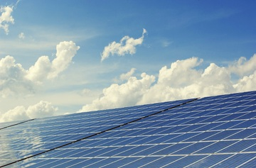 solar panels under cloudy sky