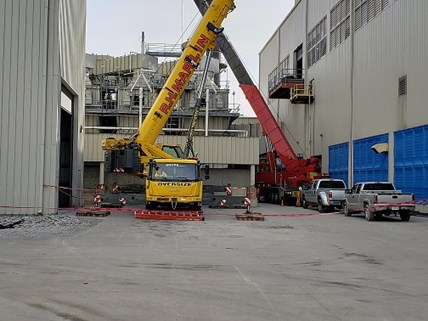 KD-KNAUF crane 1 The dueling crane pic- Looks can be deceiving as these cranes are 40 feet apart and their swing radiuses  are in opposite directions