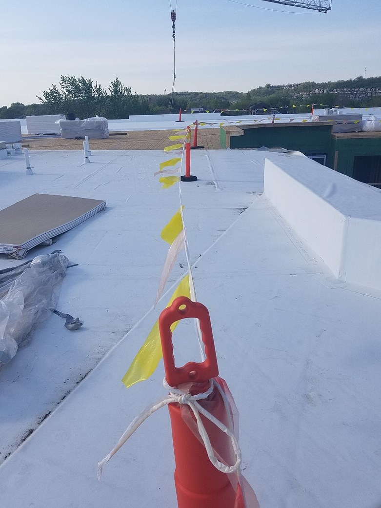 DR-FLCO RIVERHAUS - FLAGGED WARNING LINES A FORM OF FALL PROTECTION