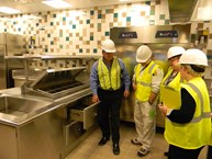 A Rep shows Parkview's Kitchen Manager and a few team members how to properly use a piece of equipment.