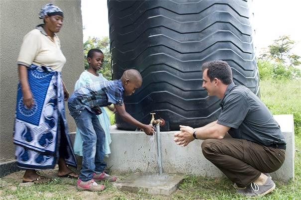 Local villagers wash face and hands with clean water in African country.