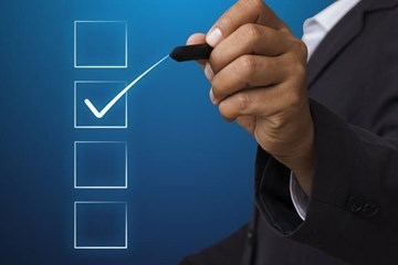 business-man-with-pen-mark-checkbox