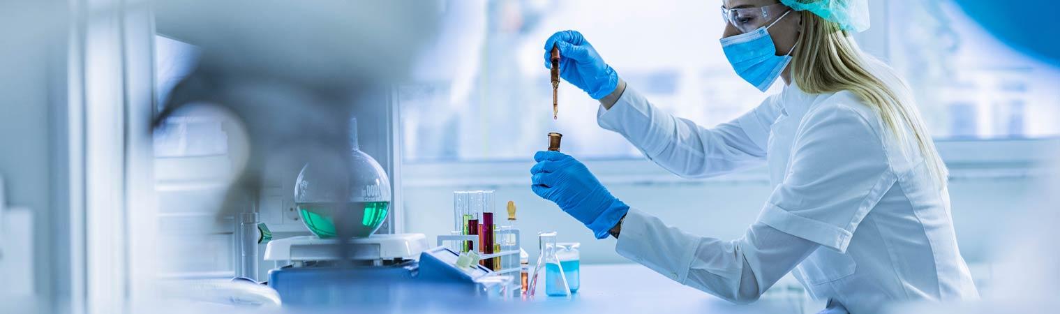 lab tech using test tube samples