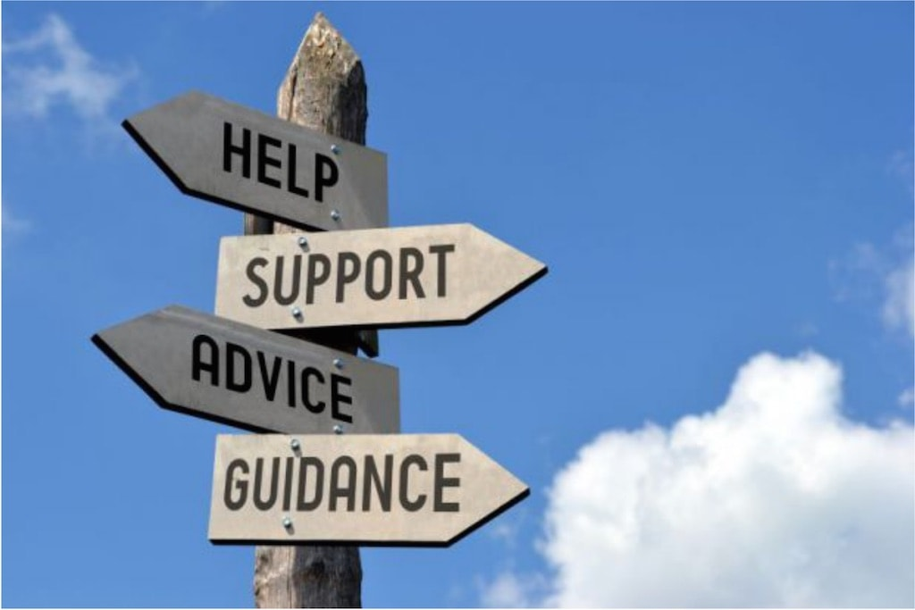 Signs pointing in different directions for help, support, advice and guidance