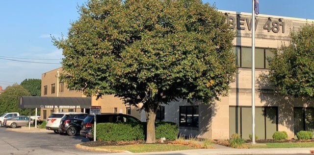 Tree beside the parking lot of the HUCU Location at IBEW 481 in Indianapolis