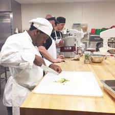 Chef Cutting Strawberries for Fast & Furious Forks Competition