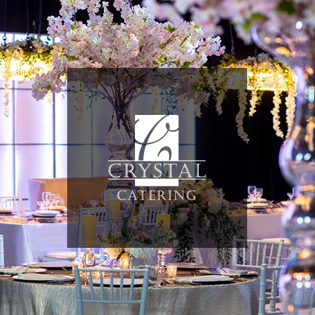 Crystal Catering company logo over one of their Indianapolis wedding reception events