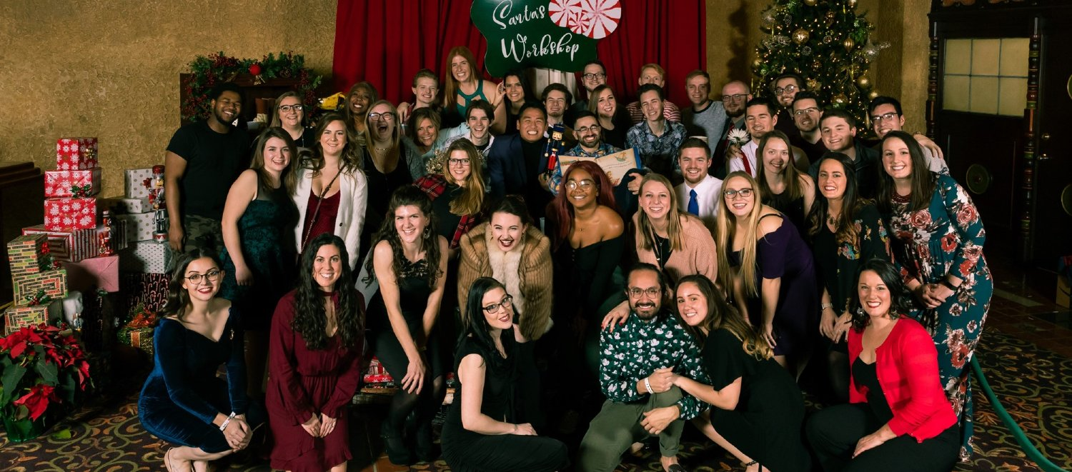 The Crane Bay Event Team posing at their holiday party