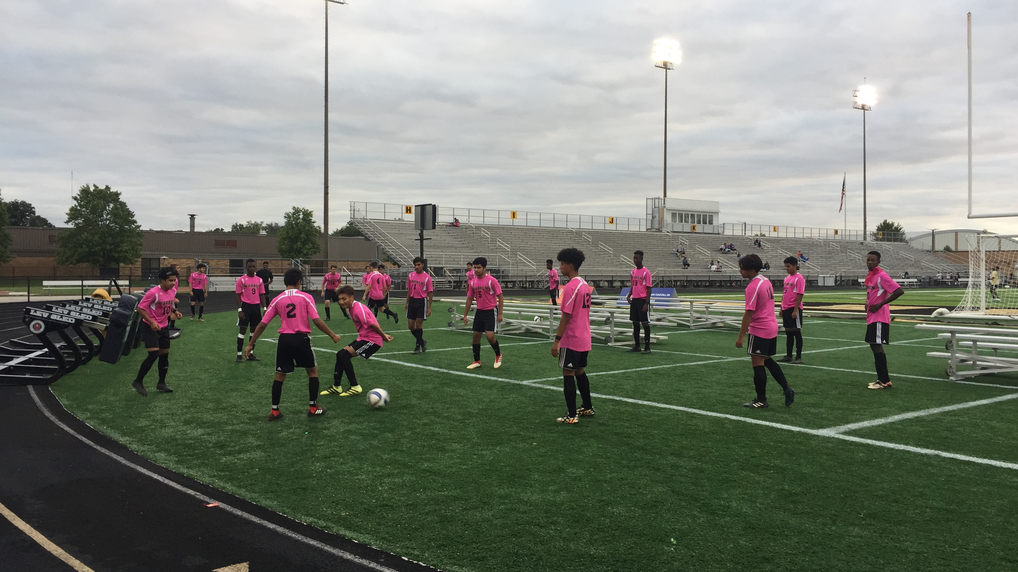Boys Soccer Warms up for Pink Night