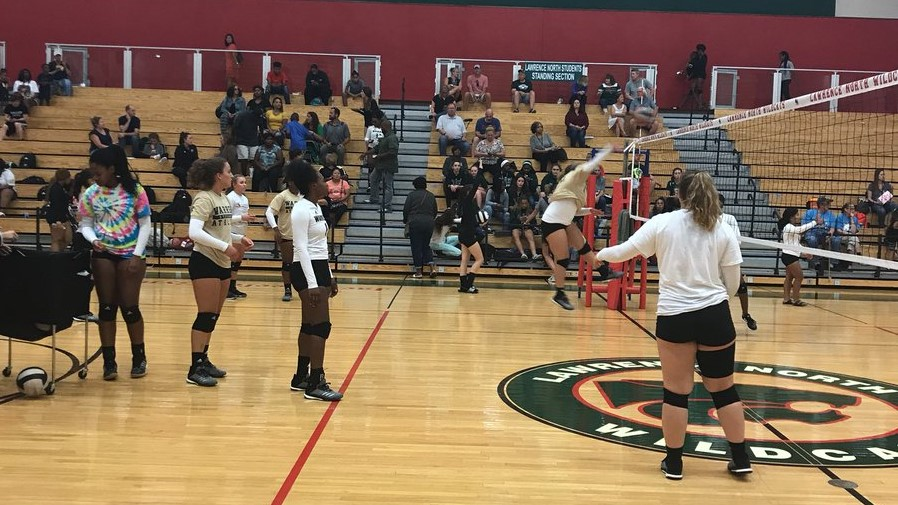 Warming up, preparing for our match with Lawrence North Lady Wildcats.