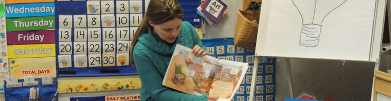 Brookview teacher reading a book